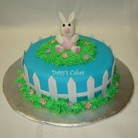 Easter Bunny Thanks to caketome for the inspiration! I had so much fun making this one! The flowers and fence pieces are gumpaste and the bunny is half...