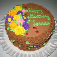 Lourdes's Basketweave Birthday White cake with raspberry filling, chocolate bc/ royal flowers and ladybugs.