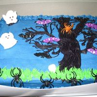 Halloween Cake My son helped do this cake. I baked it, and he decorated it for the most part. I did borders. He freehanded the tree. The bats, skulls, and...