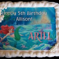 Ariel Cupcake Cake The Little Mermaid/Ariel Cupcake Cake. I created the picture with a graphics tool and printed it on a frosting sheet.