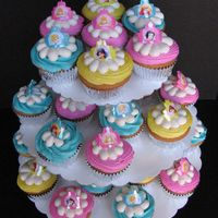 Princess Cupcake Tower Individual cupcakes with princess rings on a disposable cupcake tower