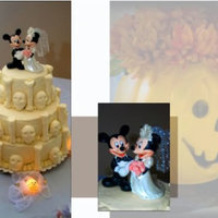 Halloween Wedding Cake This is my daughters wedding cake. She got married last Halloween with a costume ball wedding. The bottom tier is white with raspberry...