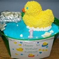 Rubber Duckie In Bathtub  12x18 sheet cut to fit the tub - tupperware canisters in bottom holding the cake to correct height - buttercream icing - soap is white...