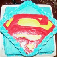 "Stupidman As We Call Him   6"" square trimmed in buttercream 8' on bottom. Logo is traced with melted candy melts."
