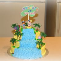 Dora The Explorer First attempt at tiered cake and it was one of my easiest. Had a lot of fun with this cake and my daughter loved the waterfall.