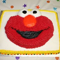 Elmo Birthday Cake TIme ran out on making two seperate cakes so I stacked them to keep the same # of servings. Thought it made Elmo stand out more too!!