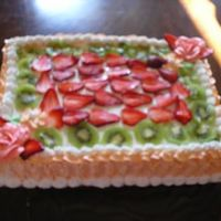 Pastel De Tres Leches !/4 sheet of pastel de tres leches decorated with fresh strawberries and kiwi.Yummm