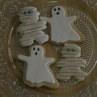 Halloween Ghost & Mummy Cookies I did these for a Halloween Party. Sugar cookies - ghosts are covered in MMF and faces are colored in with food writers. Mummy is covered...