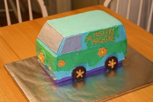 Scooby Doo 3D Mystery Machine Mystery Machine from Scooby Doo. Cake is 12 inches long, 6 inches wide, and about 6.5 inches high. All buttercream and cookie tires. I...