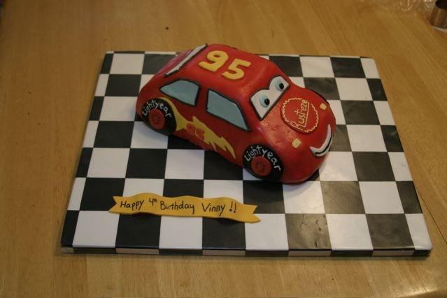 "Lightning Mcqueen Cake #2 Did this for a friend's b-day party. Wilton 3D car cruiser pan. Everything is MMF. I forgot to get a picture of it with the ""..."