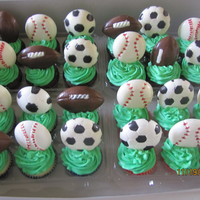 Sports Cupcakes Assorted flavor cupcakes with homemade sports chocoate toppers. TFL