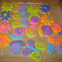 Butterflies, Flowers, Snails All done with buttercream icing--the customer loves bright colors.