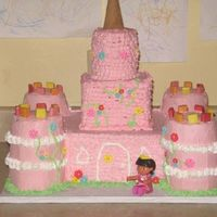 "Dora's Castle  Yikes....this was the first cake I ""built""! It was really hard! The 4 towers are 3 4"" round cakes stacked. Then the middle..."