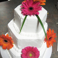 Gerbera Daisy  This cake was planned then I had to change it when I got there. It was for my cousin. She got the flowers and also was going to have ribbon...