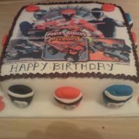 Power Rangers Another power rangers cake, my cousins children are all obsessed!! All fondent with an edible image on top.
