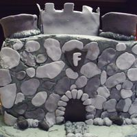 Castle Cake Made for ten year old birthday, buttercream with fondant accents, water is royal icing.He loved it and it was fun to make.