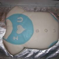 "Baby Boy Onezie This is my first attempt at this baby shower cake. It is a white baby's onezie with a ""I Love You"" blue bib. The cake has..."