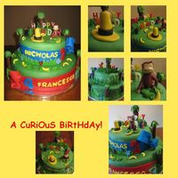 A Curious Birthday I got the inspiration for this cake from similar cakes on this board. I used twix bars for my tree trunks instead of pretzel sticks.The...