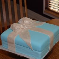 Tiffany Box Here is my cake of first's. First time for gumpast/fondant bow, luster dust, satin ice, bridal shower cake and finally it was the...