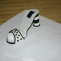 Img_5479.jpg This is my first attempt at making a shoe out of gumpaste and fondant. So far like the way it looks. I still have to make the matching cake...