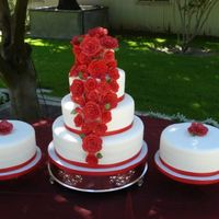 Red Sugar Roses This cake was a request by a bride who's entire wedding was adorned by red roses.