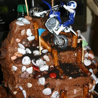 Mason's Dirt Bike Cake This was kind of a cake disaster but it tasted great and my son loved it. Based on one from a magazine. My cake was too moist and kept...