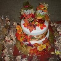 Fall Wedding Cake This cake was for a bride and groom that had a fall theme, complete with pumpkins and scarecrows. This was my very first time covering a...
