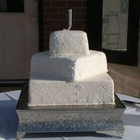 "Damask Print Wedding Cake Square wedding cake with damask royal icing ""print"". ""Print"" was made using a stencil."