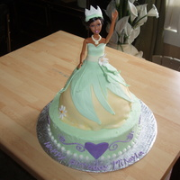 Princess And The Frog Cake   Princess Tianna cake is fondant, the supporting cake is buttercream.