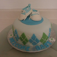 Baby Converse Baby Shower Cake   Shoes made from fondant. Cake is WASC with vanilla BC icing covered in fondant