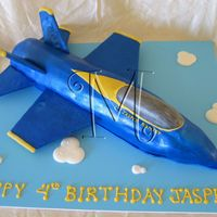 Blue Angel Airplane Blue angel scultpted from loaf cakes. Covered in fondant. Wings are cardboard covered in fondant. Thanks to Doug for his help.