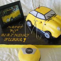 Yellow Mini Cooper Mini cooper cake carved from 3-D cruiser...also made a small logo cake to feed the number of guests.