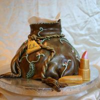 Purse Cake Inspired by one of Colette's cakes. Used the wilton wonder mold and carved it. Covered in chocolate fondant and decorated with royal...