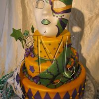 Mardi Gras Mardi gras cake donated to charity event.