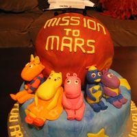 Backyardigan's Mission To Mars Backyardigans all made of fondant. Mars is from sports ball pan, covered with red, orange and brown fondat, all swirled together.