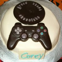 Cake_009.jpg I made this for my brother's birthday. He loves video games. The cake is a butter cake with buttercream dream icing. The controller,...
