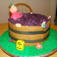 Grape Smashing Three 10 inch rounds layered in BC. Decorated in fondant.