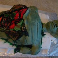 Alien Disection Cake covered in fondant. The head is rice krispy treat