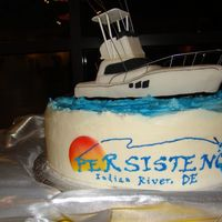 Fishing Boat Boat is rice crispies and fondant. Cake is BC except sun and fish they are fondat. Everthing is edible except wire on boat. Name on cake is...