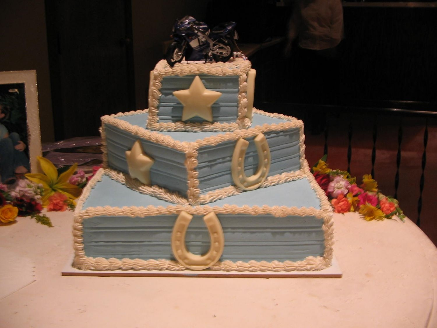 Img_0240.jpg western wedding cakewhite almond cake, whipped cream icing, stars and horseshoes made out of white choc.