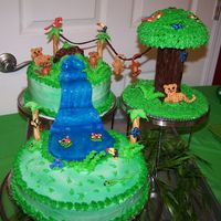 Baby Rain Forest 3 tier cake, 1 layer white, chocolate & strawberry. buttercream icing with royal icing characters. everything is edible. made for...