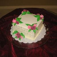 "Roses And Pearls   6"" square, chocolate cake with vanilla BC filling and icing. Fondant leaves and Duff roses."