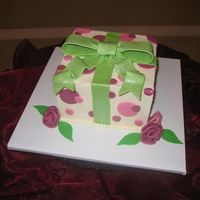 "Giftbox With Roses  6"" square with fondant/gumpaste bow and fondant accents. Cake is the Chocolate ItalianCream Cake from this website. It is truely..."