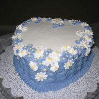 "Flower Basket  8"" white cake with raspberry filling, BC icing, RI flowers. It's one of the cakes from a Wilton book that I wanted to make. The..."