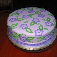I_Like_Purple.jpg   Nati's chocolate cake with whipped white chocolate ganache filling and MMF. I was just practicing brush embroidery.