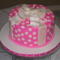 "Polka Dots And Bow   8"" Chocolate cake with raspberry filling, buttercream icing. Fondant details. Gumpaste bow"