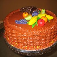 Thanksgiving   10 inch yellow cake with chocolate BC and marzipan fruits and vegetables.