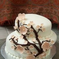 Cherry Blossom Tier This is a two tier fondant covered cake. I tried to do a mad hatter cake but I off set the bottom to much so is a little too tilted. I am...