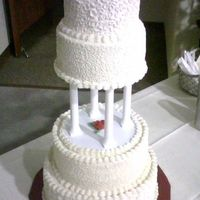 Red Roses Antique White alternatine chocolate & vanilla cake w/off-white colored BC icing & red roses on top