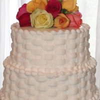 Mandy's Basketweave Wedding Cake This was actually my FIRST wedding cake. I was really pleased with the way it turned out. This was a vanilla cake with raspberry filling,...
